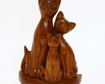 Carved Wooden Figurine of a Trio of Cats