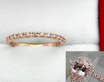 14K Rose Gold and Diamond Anniversary Wedding band with 14 round diamonds (.12 Cts Tw)