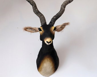 Large black antelope textile trophy. Safari animal head, fabric wall sculpture. Vegetarian hunting statement art.