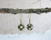 dangle earrings with white and dark olive green polka dot vintage acrylic beads