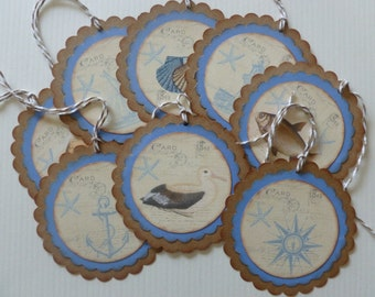 Beach themed tags nautical destination wedding favor tags vintage style blue and beige scalloped lighthouse shells anchor ship - set of 8