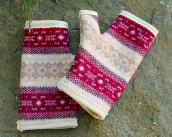 Recycled 100% cashmere and wool fingerless gloves.  Fair Isle in raspberry and shades of pink and cream.  Cream lining.