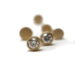 Classic gold diamond studs   18k yellow gold