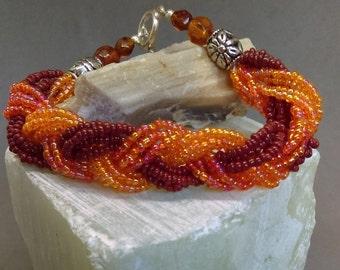 Dark orange braided seed bead bracelet with crystals, Fall season jewelry
