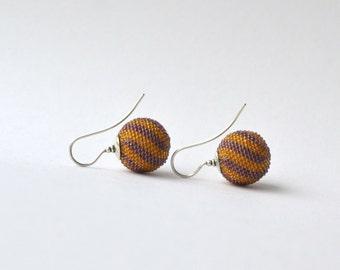 globe earrings lila mustard  twisted