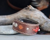 Kangaroo Leather Southwestern Style Cuff Hand Saddlery Stitched in Medium Brown, Red and Ochre with Metal Feature Bead