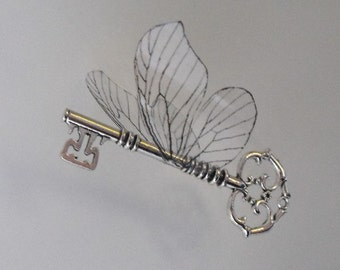 Magical flying key with large butterfly wings in shiny silver - SSOLBF
