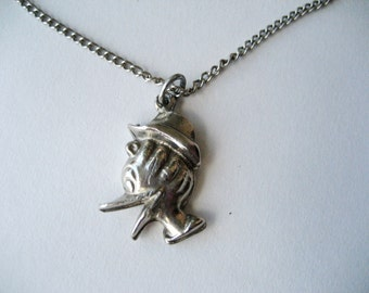 Vintage cartoon duck pendant necklace from Germany. Donald Duck. Silver tone.