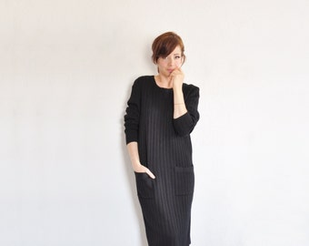 black knit Ferragamo dress . pockets galore . high fashion shift .medium.large