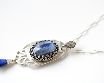 Blue kyanite and lapis pendant in sterling silver with cut out detail and a sterling silver chain.