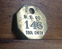 Vintage Brass B. E. Co. Tool Check Tag. Number 146.  Industrial Craft Supplies.