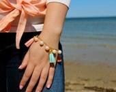 Gold Pearl and Tassel Charm Bracelet.