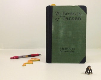 Hardcover journal from old book, The Beasts of Tarzan. Handbound book journal with ribbon page marker, pocket, and vintage book page art.
