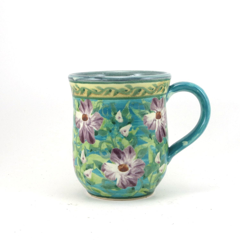 Pottery coffee mug blue porcelain with purple flower design for Blue mug designs