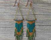 FORT BRAGG. Jade with teal, topaz, and grey glass beaded earrings.