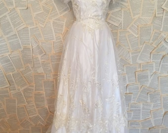 Vintage embroidered white beaded bridal wedding down dress full length floor flutter sleeves sheer layered tiered maxi train