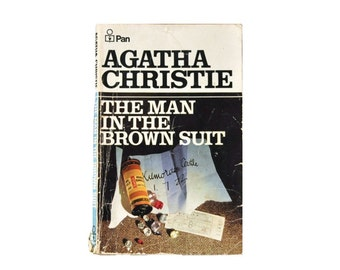 1977 Pan Paperback. The Man in the Brown Suit, by Agatha Christie. 1970s. Book. Books. Mystery. Crime. Fiction.