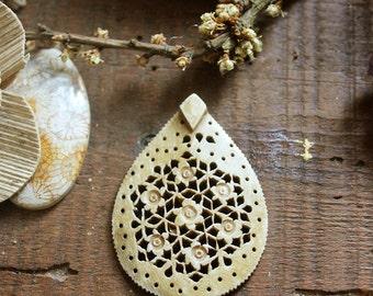 Carved Sacred Geometry Floral Bone Pendant