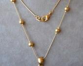 ANNE KLEIN Long Gold Pendant Necklace