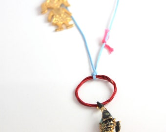 girl fish necklace