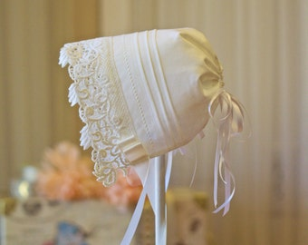Beautiful heavy lace edged pintuck baby bonnet
