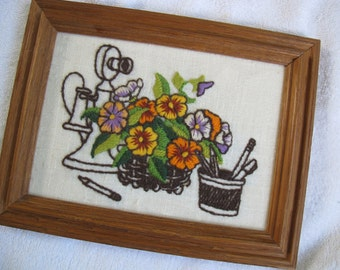 Vintage framed crewel work picture of orange flowers and antique telephone