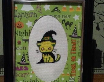 Halloween witch kitty cat cross stitch in custom matted frame.