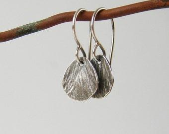 Silver drop earrings. Small dainty earrings in textured silver.