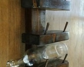 three bottle wall mounted wine rack with repurposed wood and masonry nails