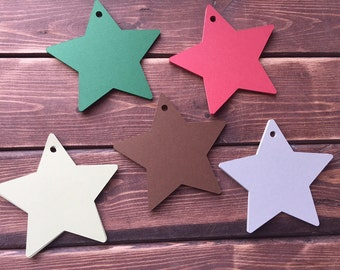 25 die cut paper star tags.....you choose size.  Christmas tags.  Star tags.