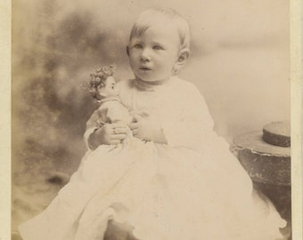 Toddler in White Holds Doll - sweet cabinet card image