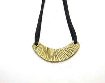 Adrie necklace - cast brass pendant on leather lace