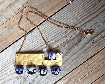 Golden and blue aluminium and handblown glass beads necklace