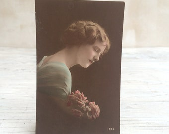 Beautiful lady with pink roses, collectable vintage postcard, elegant romantic image, postmarked 1912.