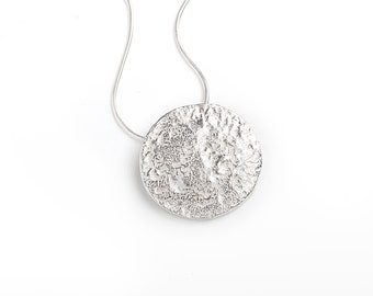 Handmade organic round silver necklace