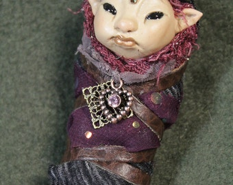 Fairy Baby Changeling in wine colors with sparkles and swarovski crystal measures 4 inches