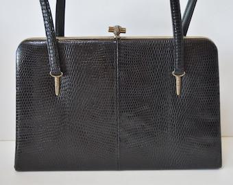 Black  leather lizard skin handbag, made in Kobe, Japan