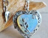 White opal quartz music box locket, heart shaped locket with music box inside, in silver tone with white opal quartz crystal heart.