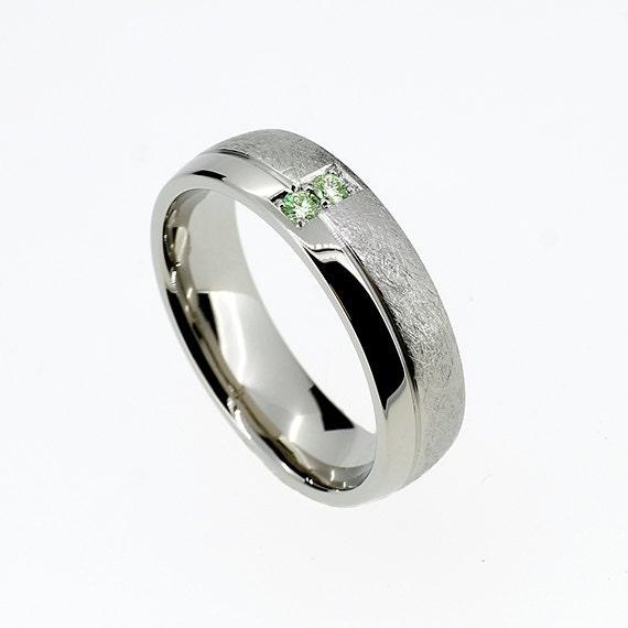 palladium wedding band with green diamonds modern scratched