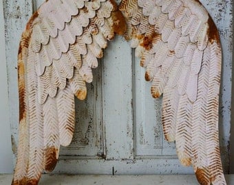 Rusty pink metal angel wings wall hanging shabby cottage chic accented white distressed large ornate wing set home decor anita spero design