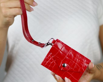 Red card holder with removable hand strap. Mini purse. Wallet. Card case. Envelope wristlet. Fold wallet. Keychain.