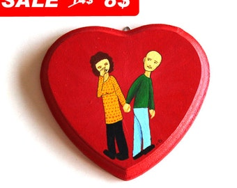 Winter Sale on a couple Holding hands illustration on wood painted in red heart decoration