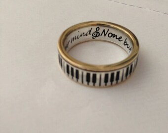 Piano Ring 9ct gold rimms