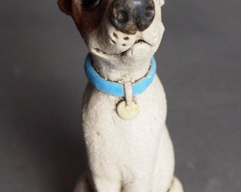 Miniature Dog with Little Bird