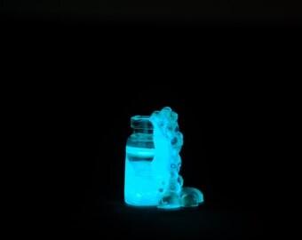 Glowing miniature potion bottle, glow in the dark bubbling potion, miniature glass bottle, fairy magic