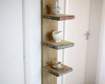 Futurustic, floating scaffold board shelving unit.
