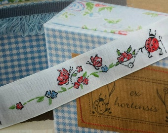 Woven satin ribbon with ladybirds  (price per meter)