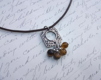 Brown leather necklace with tiger eye stone pendant