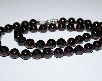 Necklace garnet beads.