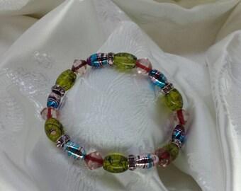 Green, purple and pink elastic beaded bracelet